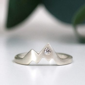 sterling silver diamond mountain ring on white and leaf background