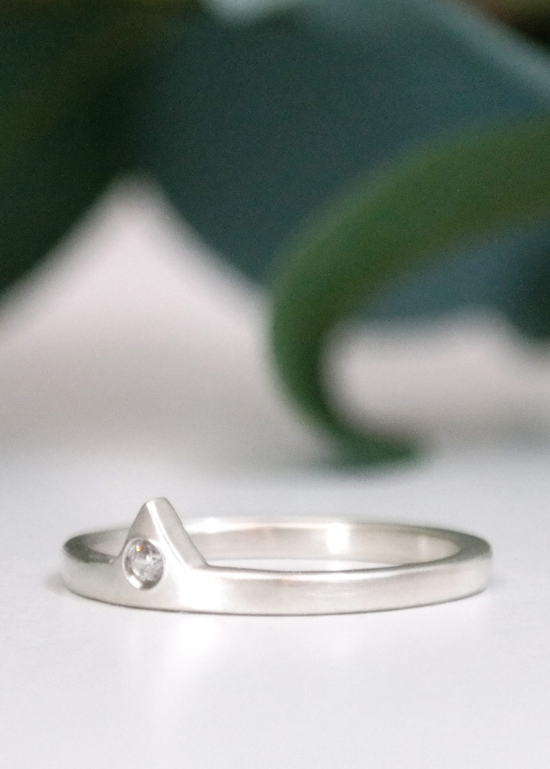 side view of sterling silver diamond on white with leaf background