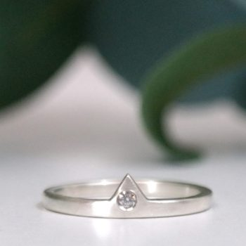 sterling silver diamond triangle stacking ring on white background