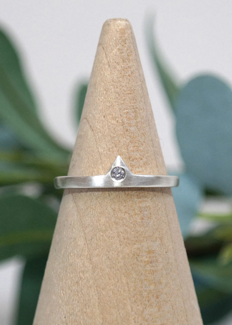 sterling silver diamond ring on a ring stand