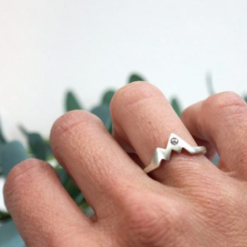 woman wearing a sterling silver diamond mountain ring