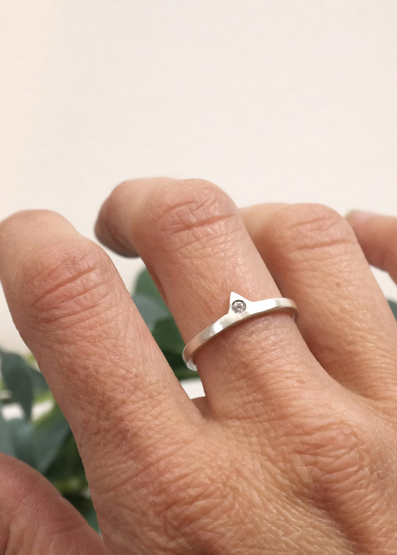 person wearing a sterling silver diamond ring